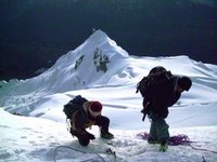 Eliseo Hammering Down an Ice Anchor